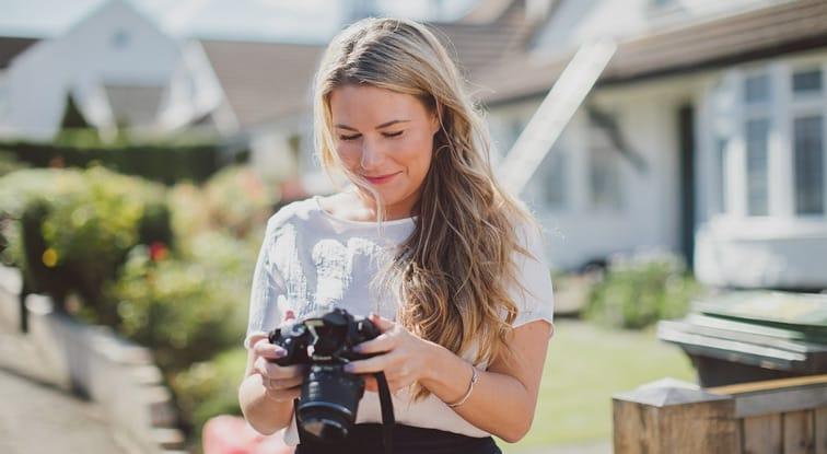 Ashton Payne holding camera